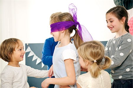 Children on birthday party playing Blind Man's Bluff, Munich, Bavaria, Germany Stock Photo - Premium Royalty-Free, Code: 6115-08066246