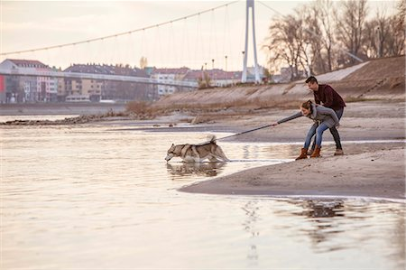 pulling - Couple with Dog Outdoors, Croatia Stock Photo - Premium Royalty-Free, Code: 6115-08066373