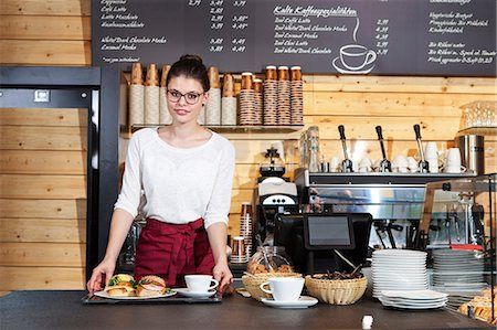 fresh - Waitress in coffee shop serving sandwiches on a tray Stock Photo - Premium Royalty-Free, Code: 6115-08100526