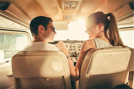 Young couple sitting in cockpit of propeller airplane Stock Photo - Premium Royalty-Free, Code: 6115-08100850