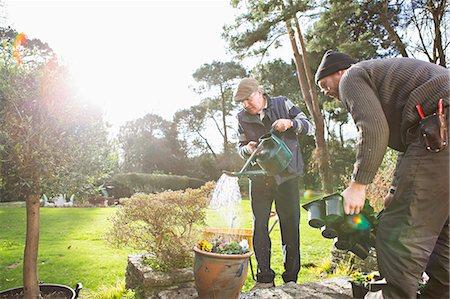 Senior man watering flowers in garden, Bournemouth, County Dorset, UK, Europe Stock Photo - Premium Royalty-Free, Code: 6115-08105142