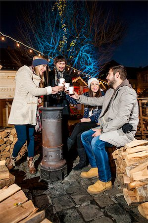 photography - Four friends drinking punch at Christmas Market Stock Photo - Premium Royalty-Free, Code: 6115-08105123