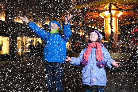 Children catching snow at Christmas Market in Bad Toelz, Bavaria, Germany Stock Photo - Premium Royalty-Free, Code: 6115-08105243