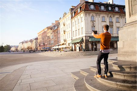 places - Mid adult man on a city break taking a picture Stock Photo - Premium Royalty-Free, Code: 6115-08416243
