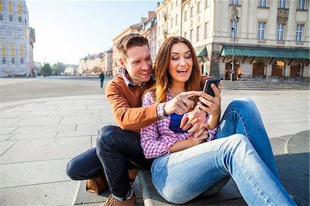 Mid adult couple on a city break using smart phone Stock Photo - Premium Royalty-Free, Code: 6115-08416248