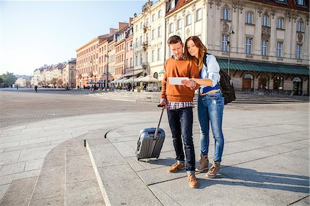 places - Mid adult couple on a city break using digital tablet Stock Photo - Premium Royalty-Free, Code: 6115-08416249