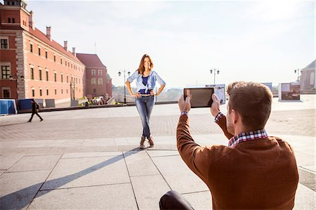 places - Mid adult man taking a picture of girlfriend Stock Photo - Premium Royalty-Free, Code: 6115-08416253