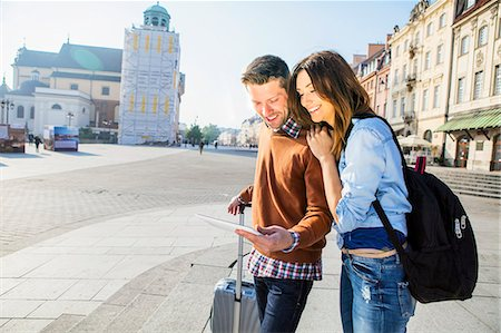 Mid adult couple on a city break using digital tablet Stock Photo - Premium Royalty-Free, Code: 6115-08416250