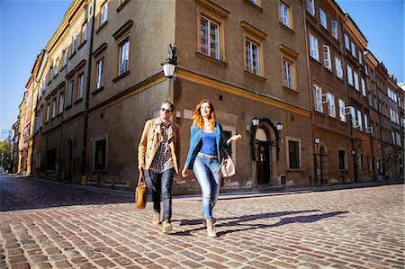 places - Mid adult couple on a city break in Warsaw Stock Photo - Premium Royalty-Free, Code: 6115-08416255