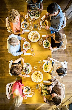 Group of friends on dinner party in restaurant Stock Photo - Premium Royalty-Free, Code: 6115-08416264