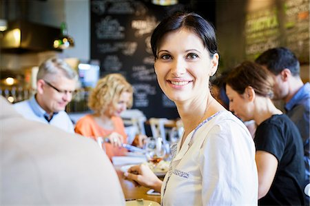 Group of friends celebrating in restaurant Stock Photo - Premium Royalty-Free, Code: 6115-08416273