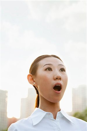 surprised - Portrait of shocked young woman outside, Beijing Stock Photo - Premium Royalty-Free, Code: 6116-06938591