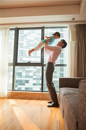 rich lifestyle - Father playing with his son Stock Photo - Premium Royalty-Free, Code: 6116-06938672
