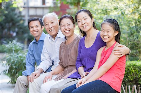 preteen touch - Three Generation Family Sitting in their Apartment Courtyard Stock Photo - Premium Royalty-Free, Code: 6116-06938811