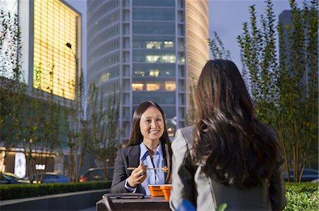 Two Businesswomen Eating Dinner Stock Photo - Premium Royalty-Free, Code: 6116-06938900