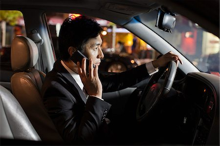 Businessman With Cell Phone In Car Stock Photo - Premium Royalty-Free, Code: 6116-06938913