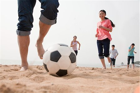 Young Friends Playing Soccer on the Beach Stock Photo - Premium Royalty-Free, Code: 6116-06939067