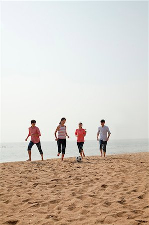 Young Friends Playing Soccer on the Beach Stock Photo - Premium Royalty-Free, Code: 6116-06939065