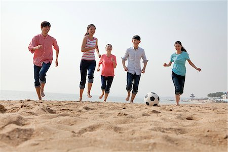 Young Friends Playing Soccer on the Beach Stock Photo - Premium Royalty-Free, Code: 6116-06939066