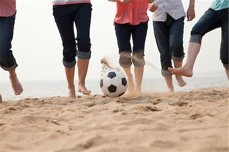 Young Friends Playing Soccer on the Beach Stock Photo - Premium Royalty-Free, Code: 6116-06939069