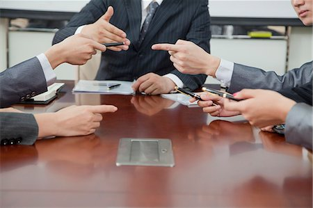 Businesspeople Making Gestures During Business Meeting Stock Photo - Premium Royalty-Free, Code: 6116-06939151