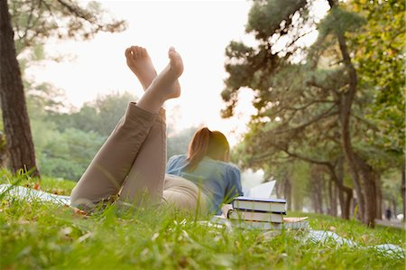 Teenage girl reading book in the park Stock Photo - Premium Royalty-Free, Code: 6116-06939111