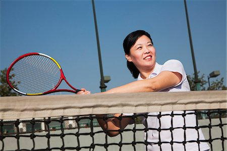 Mature woman playing tennis, portrait Stock Photo - Premium Royalty-Free, Code: 6116-06939292