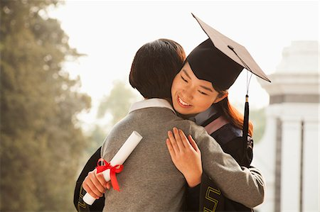 Mother and Graduate Hug Stock Photo - Premium Royalty-Free, Code: 6116-06939209