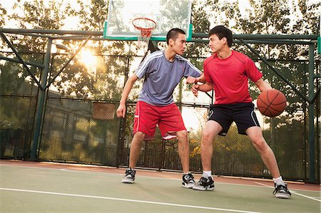 Two street basketball players on the basketball court Stock Photo - Premium Royalty-Free, Code: 6116-06939357