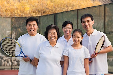 Family playing tennis, portrait Stock Photo - Premium Royalty-Free, Code: 6116-06939308