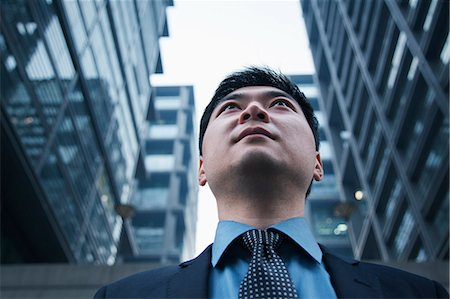 Low angle view of businessman outdoors in Beijing Stock Photo - Premium Royalty-Free, Code: 6116-06939426