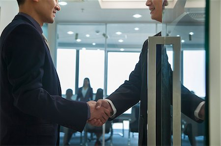 partnership - Businessmen Shaking Hands Stock Photo - Premium Royalty-Free, Code: 6116-06939581
