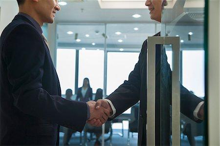 partnership - Businessmen Shaking Hands Stock Photo - Premium Royalty-Free, Code: 6116-06939581