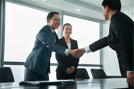 partnership - Businessmen Greeting Each Other with a Handshake Stock Photo - Premium Royalty-Free, Code: 6116-06939585