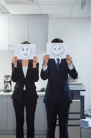 Businesspeople Holding Happy Faces on Paper Stock Photo - Premium Royalty-Free, Code: 6116-06939596