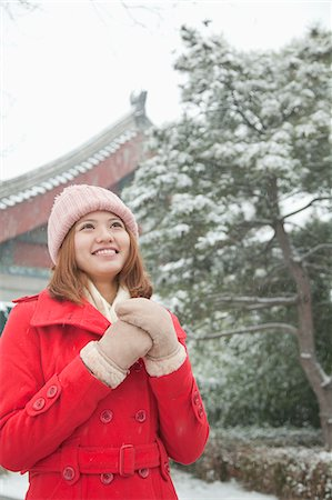 Young Woman Holding hands in snow Stock Photo - Premium Royalty-Free, Code: 6116-06939517