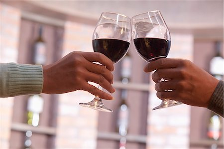 Close Up of Couple Toasting, Hands and Wineglass only Stock Photo - Premium Royalty-Free, Code: 6116-07084732