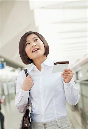 descriptive - Young Woman Holding a Train Ticket Stock Photo - Premium Royalty-Free, Code: 6116-07084847