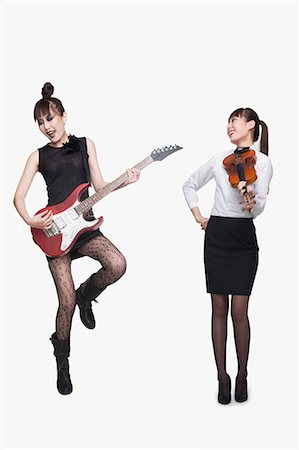 Rock star and violin player, opposite Stock Photo - Premium Royalty-Free, Code: 6116-07085009