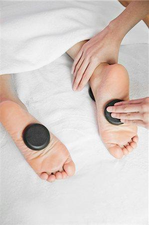 foot massage - Woman Receiving Hot Stone Foot Massage Stock Photo - Premium Royalty-Free, Code: 6116-07085760