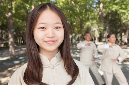 Granddaughter with grandparents practicing Tai Chi Stock Photo - Premium Royalty-Free, Code: 6116-07085942