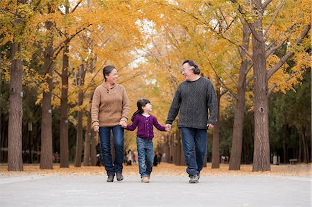 Grandparents and granddaughter playing in park Stock Photo - Premium Royalty-Free, Code: 6116-07086064