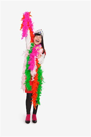 dress up girl - Girl wearing feather boas and tiara Stock Photo - Premium Royalty-Free, Code: 6116-07086273