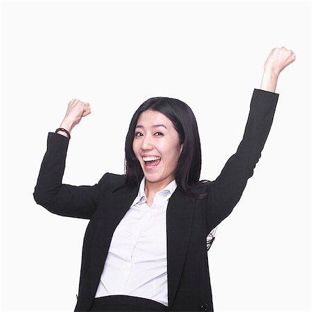 Businesswoman cheering Stock Photo - Premium Royalty-Free, Code: 6116-07086341