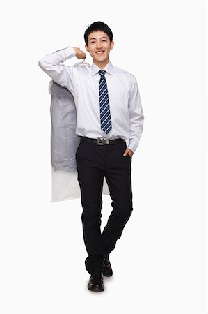 Businessman carrying laundered shirt Stock Photo - Premium Royalty-Free, Code: 6116-07086309