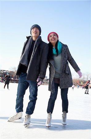Young couple skating at ice rink Stock Photo - Premium Royalty-Free, Code: 6116-07086567