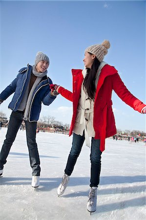 Young couple skating at ice rink Stock Photo - Premium Royalty-Free, Code: 6116-07086568