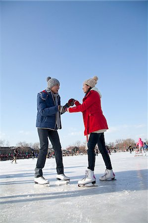 Young couple skating at ice rink Stock Photo - Premium Royalty-Free, Code: 6116-07086569