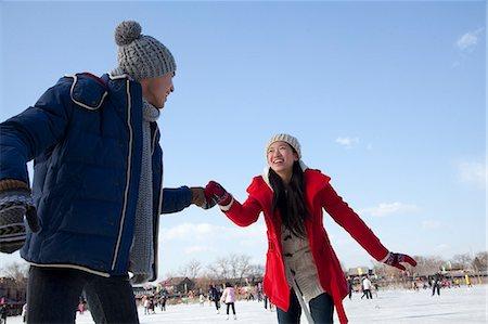 Young couple skating at ice rink Stock Photo - Premium Royalty-Free, Code: 6116-07086570