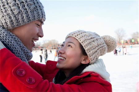 Young couple hugging at ice rink Stock Photo - Premium Royalty-Free, Code: 6116-07086571